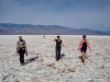 krista, adina and steph walk across badwater with thibault following